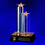 9.5 High Acrylic Double Star. A gold reflective base creating a visually stunning effect enhances two bold sculptured Lucite star columns. Personalization is accomplished by engraving a highly polished brass plate affixed to the black Lucite base.