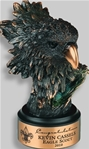 This Bronzetone Eagle Head is small yet fierce. The beak is a brilliant bronze finish. This elegantly antiqued finished figurine is on a round ebony base. A metal tone plate is provided for personalization.
