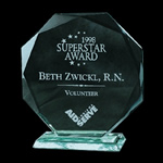 Jade Crystal Faceted Circular Octagon Award. Presented handsomely on a matching Beveled Jade Crystal Base. Hand-cut beveled edges highlight each elegant piece. Detailed reverse etching proudly adds dimension to the honor.