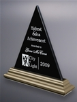 Jet black marble with a lustrous, platinum-finished wood framing striking awards in timeless designs. The peak of the pyramid is a highly desired award as a symbol of success. This glorious piece can be screen printed or deep etched and color filled.