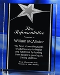No icon is as synonymous with success as the simple star. This freestanding acrylic award with silver accents is professionally laser engraved to acknowledge your top performers. Allow your stars to shine!